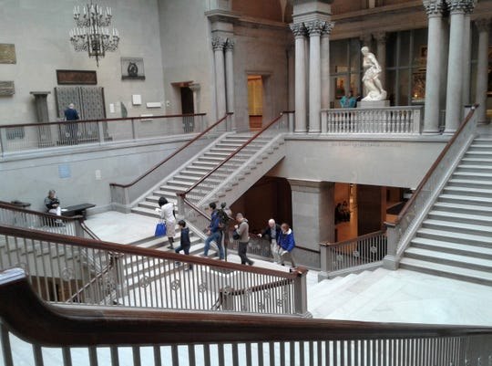 Visitors climb the ornate marble staircases in The Art Institute of Chicago, heading for the exhibit of four Rembrandt portraits in one second-story wing of the enormous museum