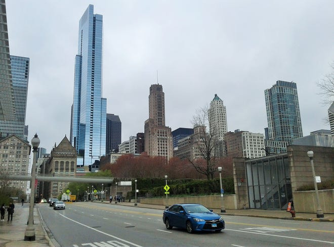 This small portion of the magnificent Chicago skyline is viewed from The Art Institute of Chicago looking westward along Monroe Street.  Prominent is The Legacy at Millennium Park residential building.