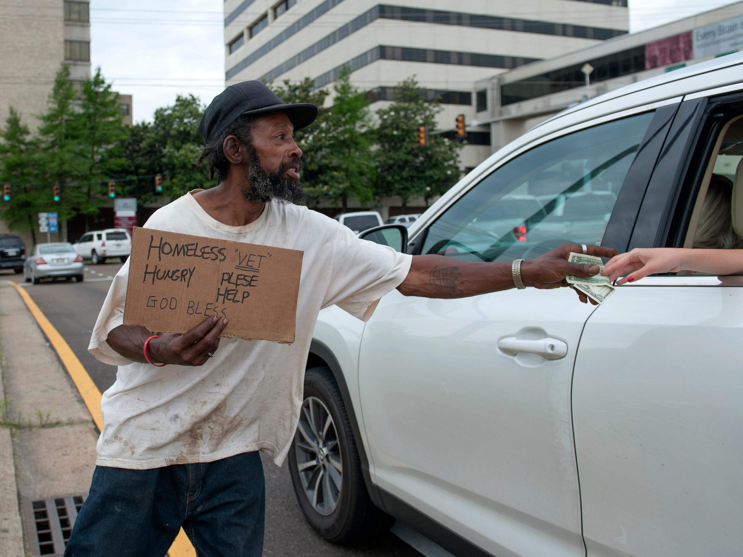 Dan, 50, who usually sleeps on sidewalks or abandoned buildings, is happy to just collect enough money for a meal. He goes to Gateway Rescue Mission to eat when he can and sometimes the restaurants in Fondren feed him. His favorite is the No. 4 from Basil's.