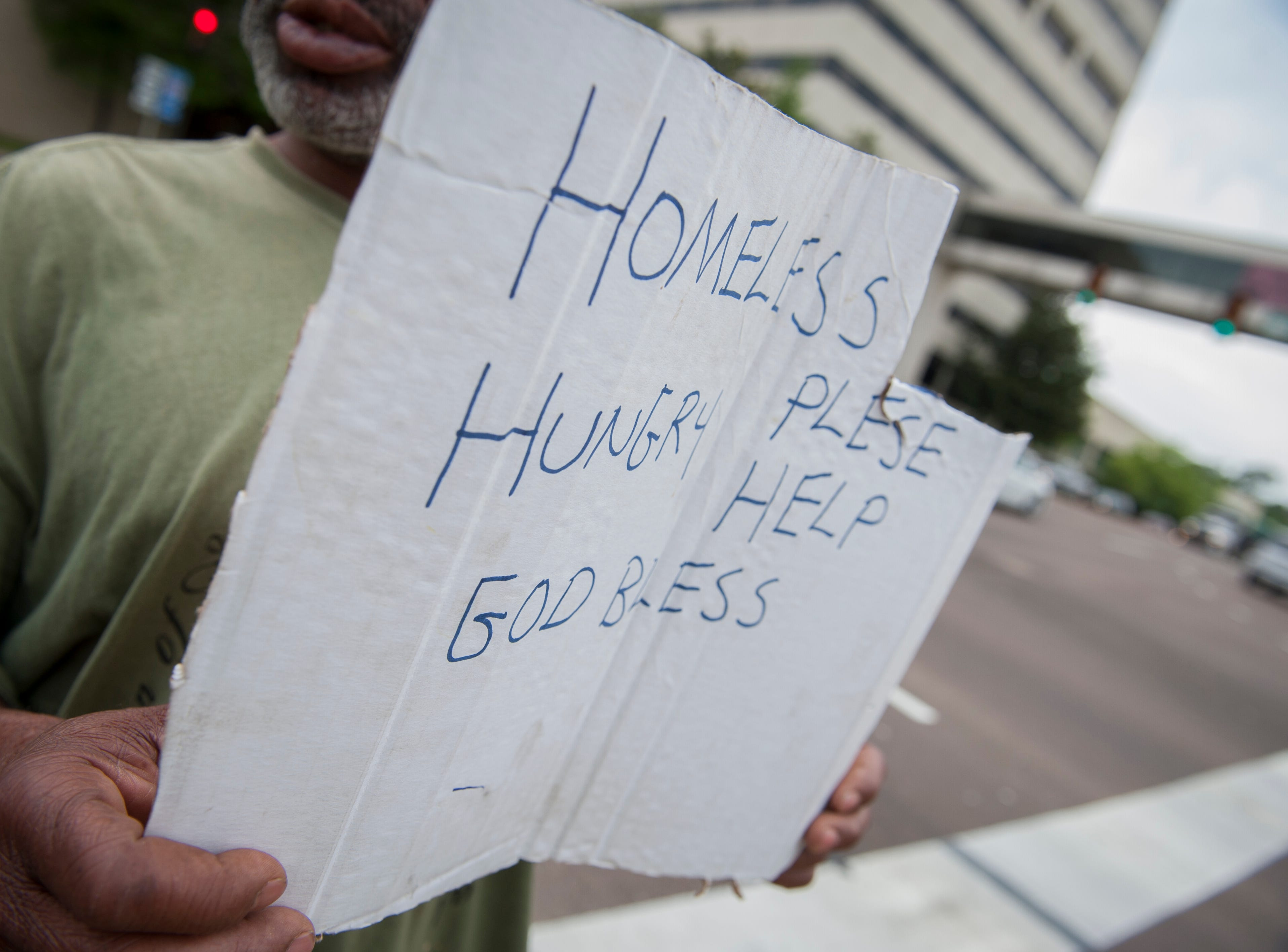 Cornelius, standing at the corner of I-55 West Frontage Road and Lakeland Drive, usually works from 30 minutes to an hour to get enough money for food. He sleeps under a bridge.