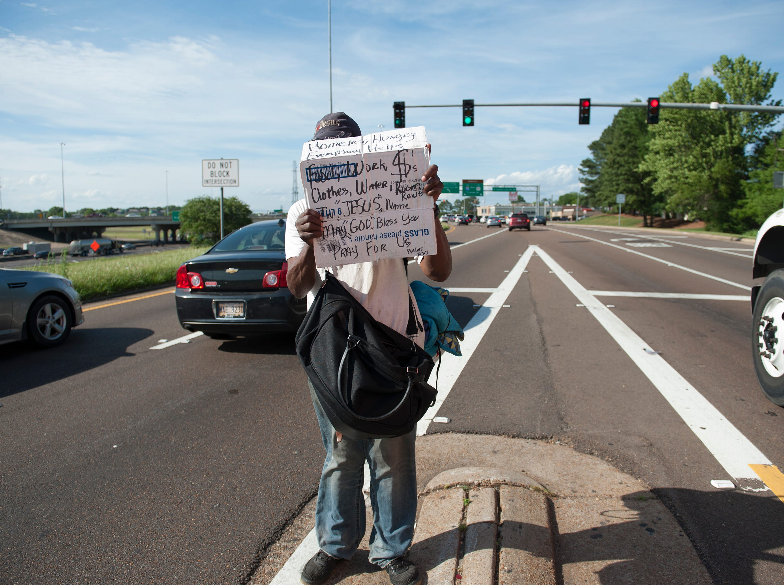 Chuck has had his spot on I-55 East Frontage Road just south of County Line Road for 10 years. He averages $50 a day through the generosity of people and has a hotel room where he sleeps in each night. This is what he does for a living.