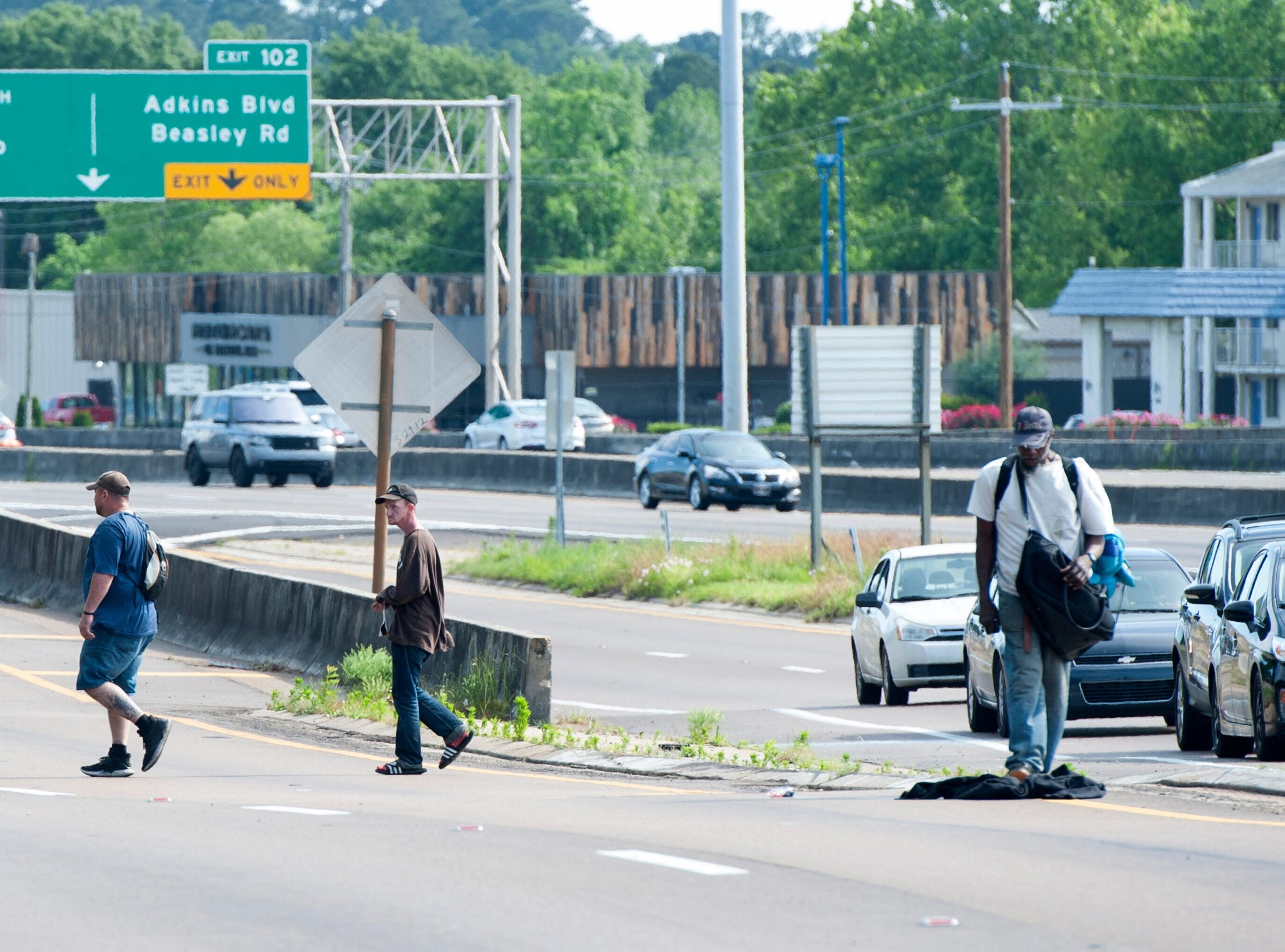 The sounds of a Jackson Police siren scared off two men who were trying to take over Chuck's spot on I-55 East Frontage Road just south of County Line Road. Taking blows to defend your spot is all part of it, explains Chuck who has called that small area of concrete his for 10 years.