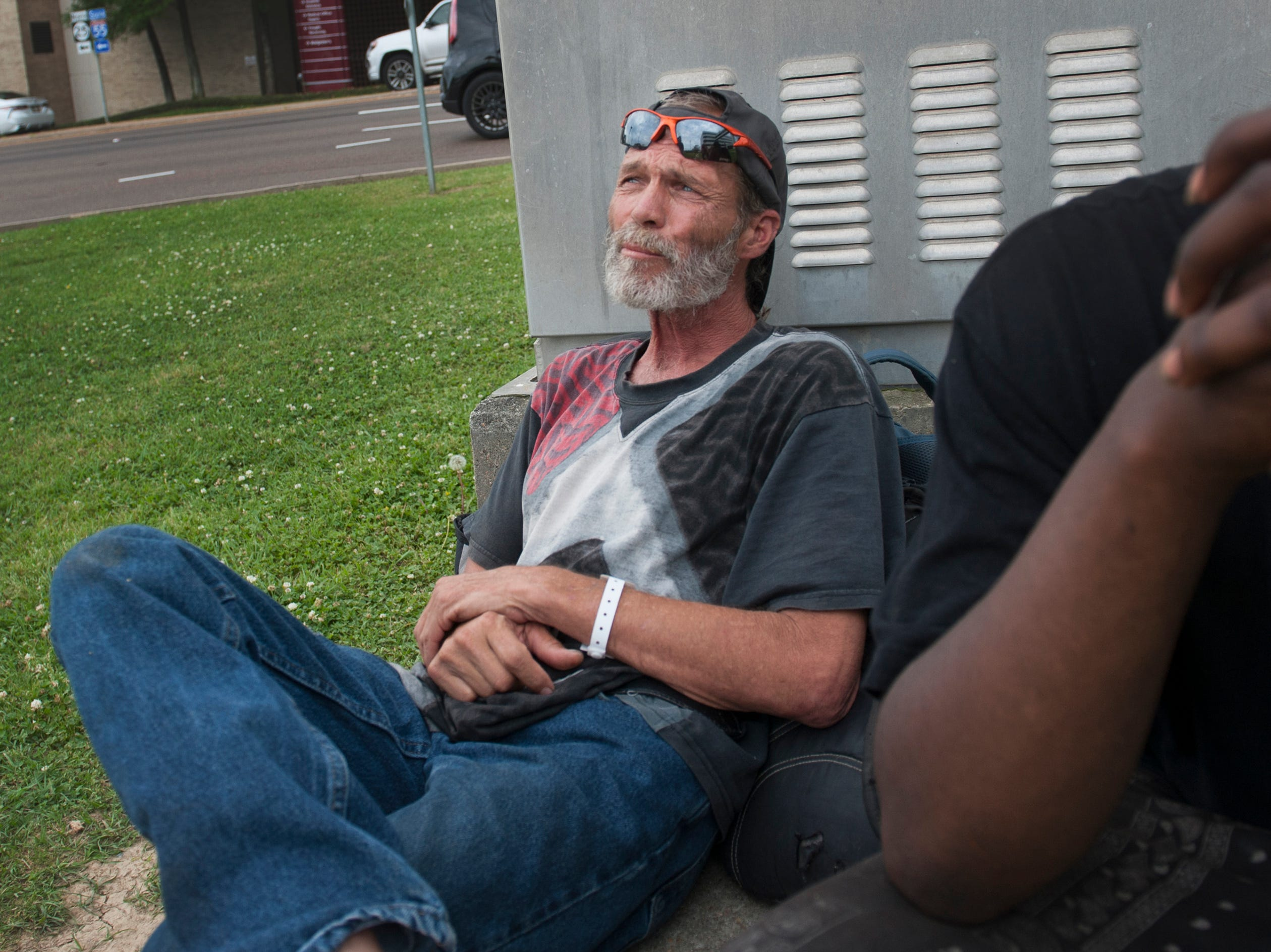 At the intersection of I-55 West Frontage Road and Lakeland Drive, Jeffery, 56, and a friend wait for Dan to finish at the corner across the street before they take his place.