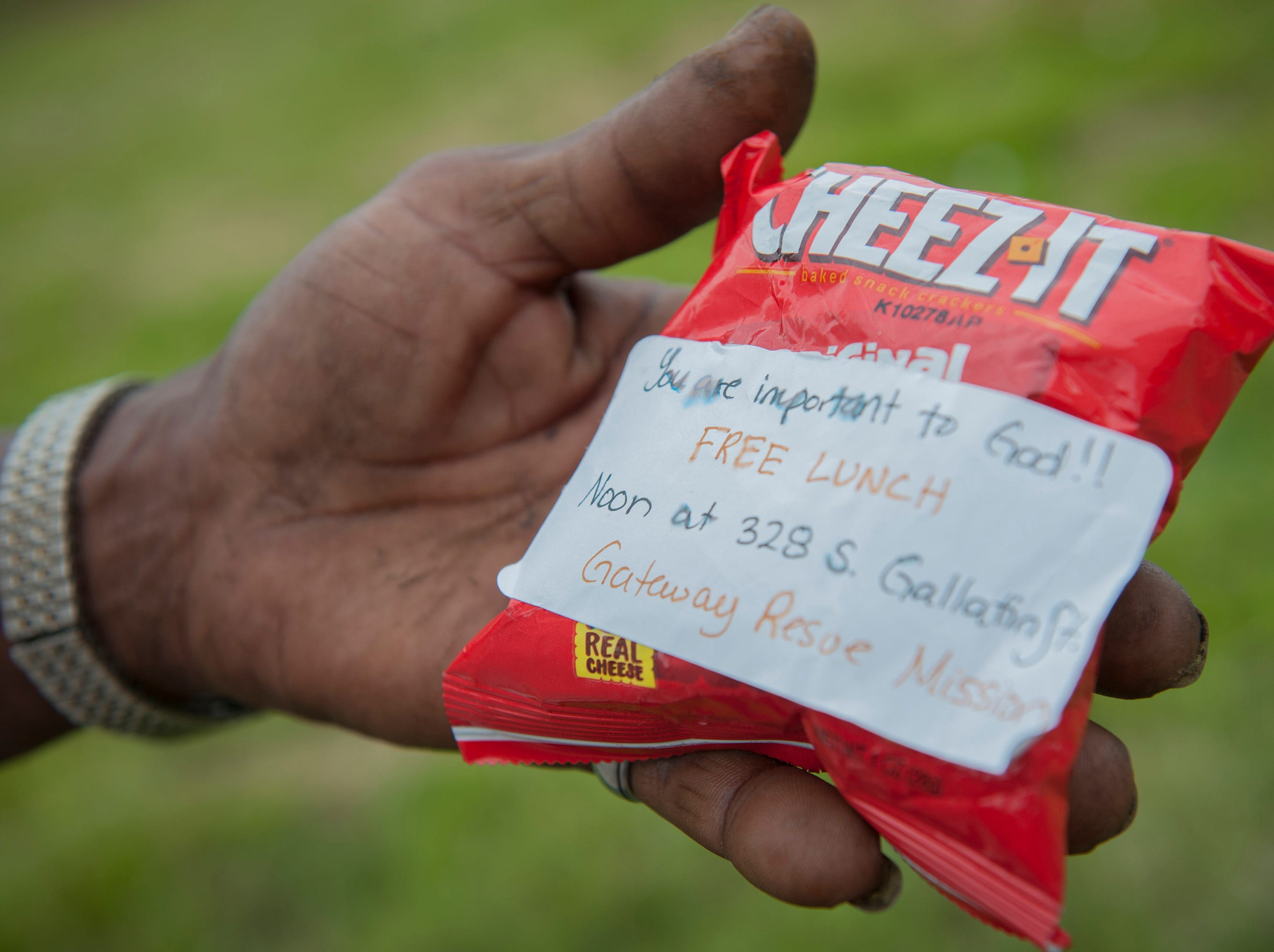 Gateway Rescue Mission left this bag of crackers with a message at the corner of I-55 West Frontage Road in Jackson. Dan was the first to find it. That means it's his. Although Dan later left it there and Cornelius came to the corner, Cornelius explained that it's Dan's and no one will take it. There's a code.