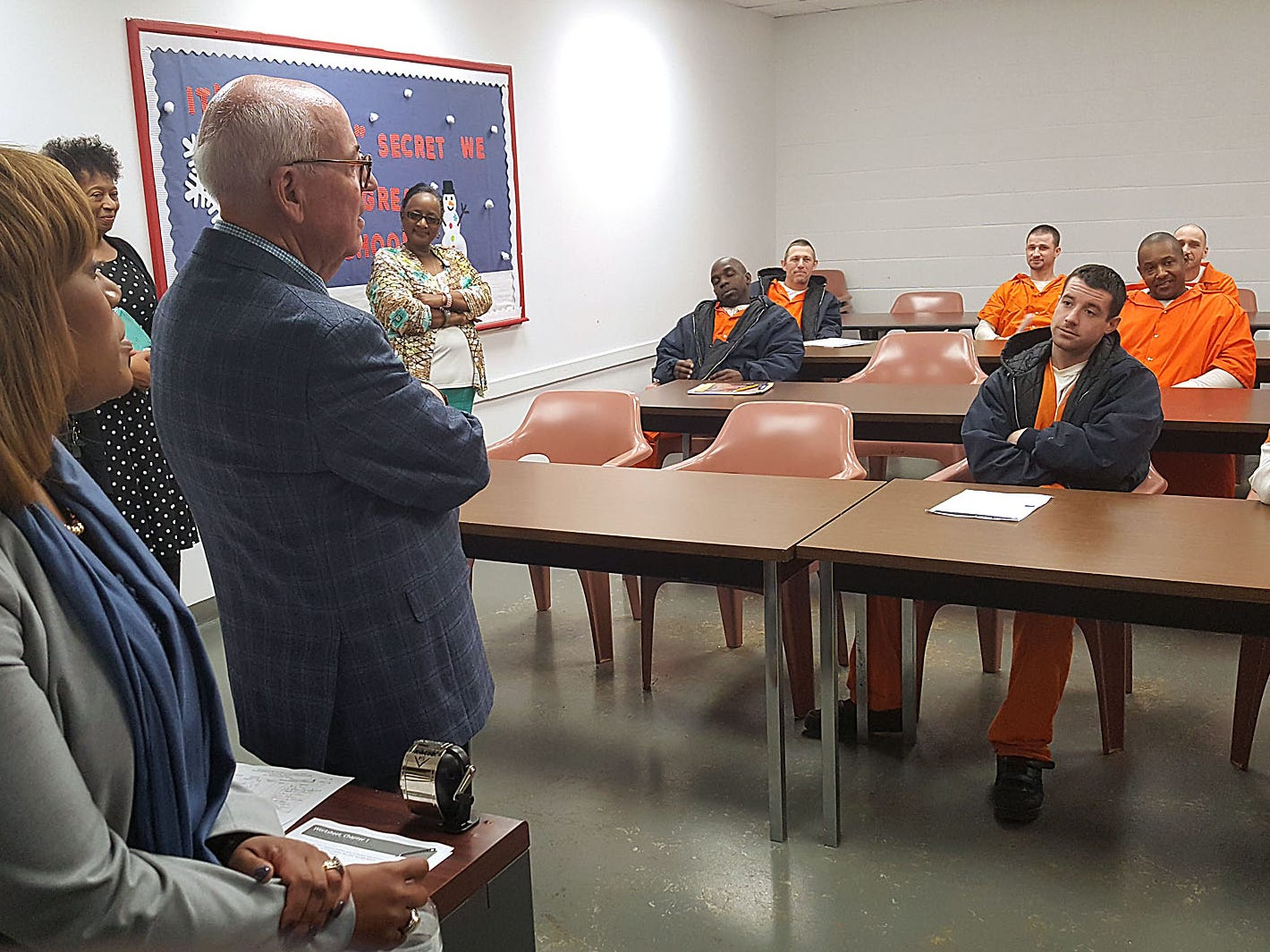 Offenders listen in a class at the Technical Violations Center in Greenwood while Mississippi Corrections Commissioner Pelicia Hall observes. The center, housed in the old Delta Correctional Facility, is designed to keep offenders from returning to prison if they're only guilty of a few technical violations.