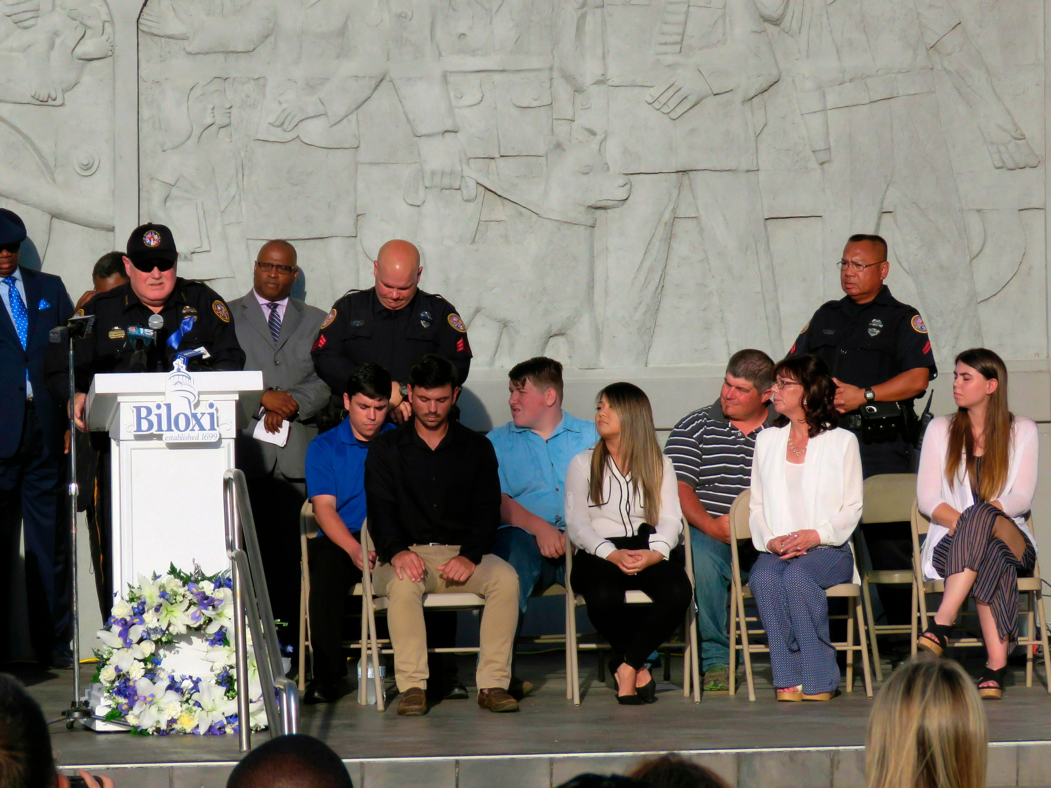 Biloxi Police Chief John Miller speaks during a memorial service for slain Patrolman Robert McKeithen while McKeithen's family listens outside the Biloxi Public Safety Center Tuesday, May 7, 2019, in Biloxi, Miss. People gathered Tuesday outside the police station, steps away from where Patrolman McKeithen was gunned down Sunday night in the parking lot.