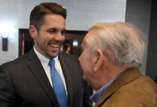 2019 Jackson mayoral candidate Scott Conger laughs with his treasurer Norwood Jones after making a speech to his supporters on Tuesday at the DoubleTree Hotel in Jackson. Conger will face candidate Jerry Woods in a run-off in June.