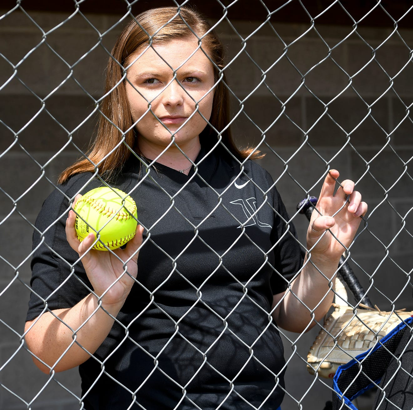 With leukemia 'completely conquered' Jackson Christian's Jenna Arnold strikes out 1,000 batters