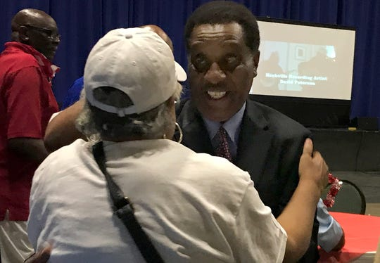 Jerry Woods hugs a supporter after securing a spot in a runoff against Scott Conger in the 2019 mayoral election on Tuesday.