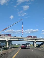 A fire truck and department personnel gathered on an overpass over Interstate 40 eastbound Tuesday evening, flying a flag in honor of fallen trooper Matthew Gatti, who was killed in the line of duty Monday.
