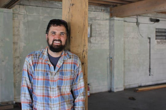 Nick Barron, owner of Albright Grove Brewing Company, poses for a photo inside the brewery at 2924 Sutherland Ave.