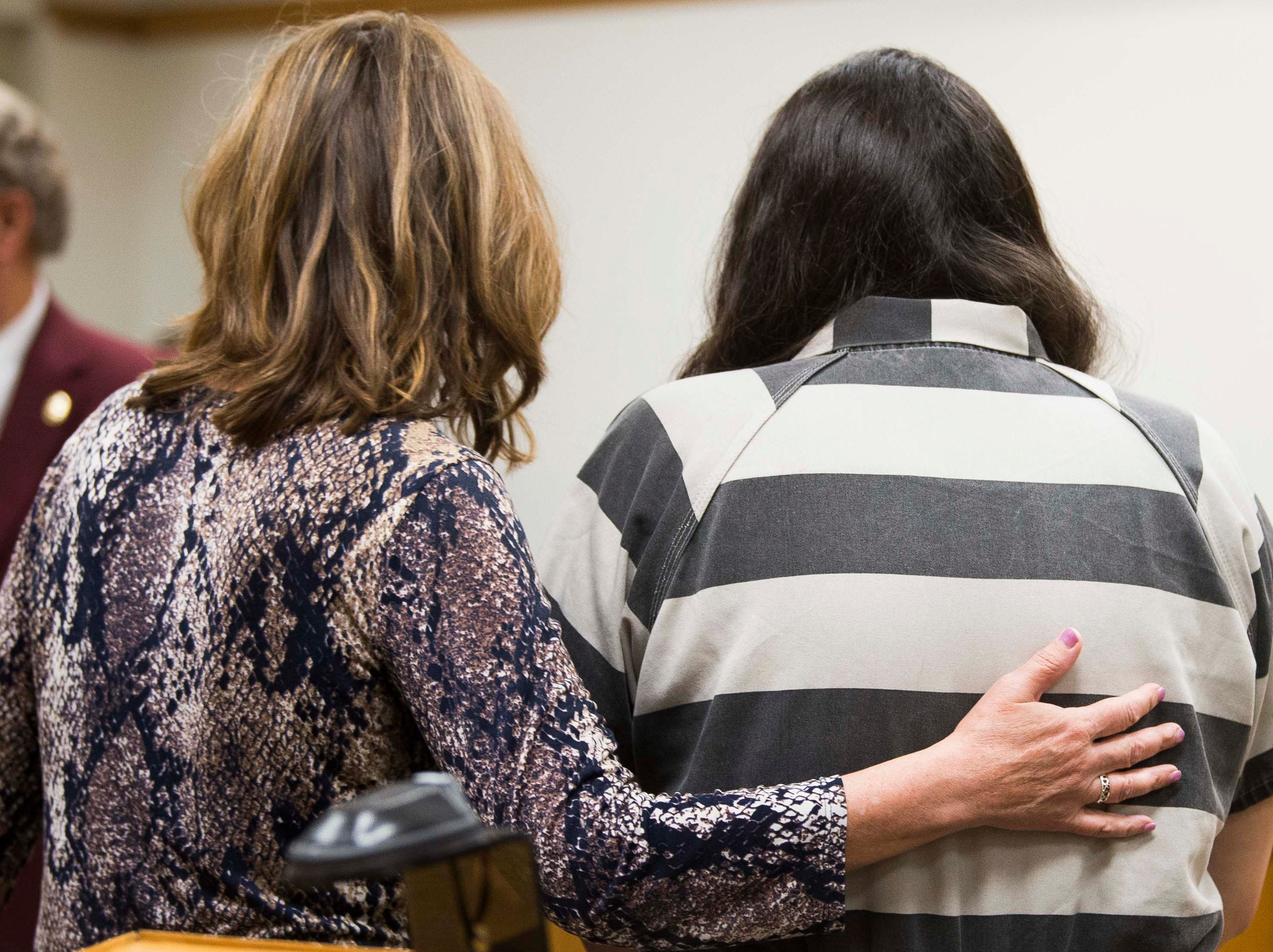 At left attorney Stacey D. Nordquist walks out of the court room with client Bethanie A. Carriker, who is arraigned before Judge Robert L. Headrick in Blount County General Sessions Court in Maryville, Wednesday, May 8, 2019. Carriker faces two counts of aggravated child neglect after a bathtub drowning left her toddler daughter dead and a second, newborn girl in critical condition.