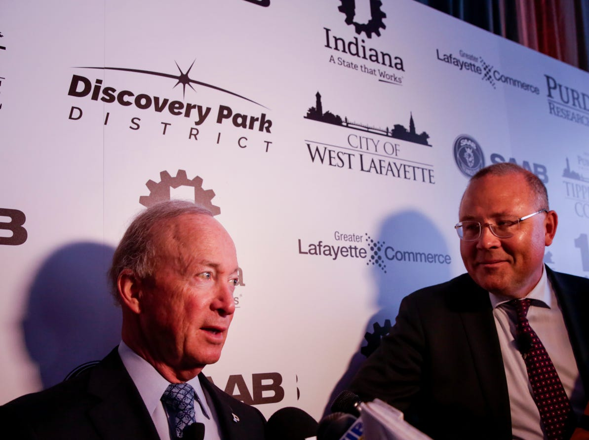 Purdue University president Mitch Daniels and Saab President and CEO Hakan Buskhe speak to the media after the announcement for a new Saab jet plant in West Lafayette, part of a $1 billion west campus plan, Wednesday, May 8, 2019 at the Purdue University airport in West Lafayette.