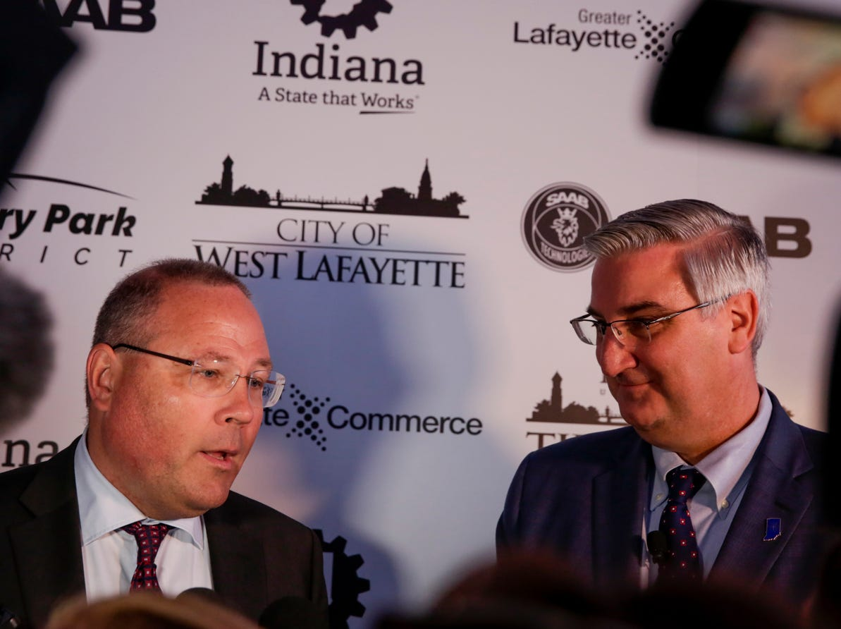 Saab President and CEO Hakan Buskhe and Gov. Eric Holcomb speak to to the media after the announcement for a new Saab jet plant in West Lafayette, part of a $1 billion west campus plan, Wednesday, May 8, 2019 at the Purdue University airport in West Lafayette.