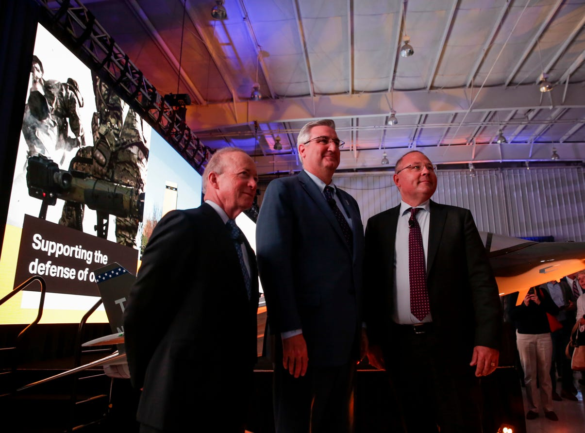 From left, Purdue University president Mitch Daniels, Gov. Eric Holcomb and Saab President and CEO Hakan Buskhe pose for a photo after an announcement for a new Saab jet plant in West Lafayette, part of a $1 billion west campus plan, Wednesday, May 8, 2019 at the Purdue University airport in West Lafayette.