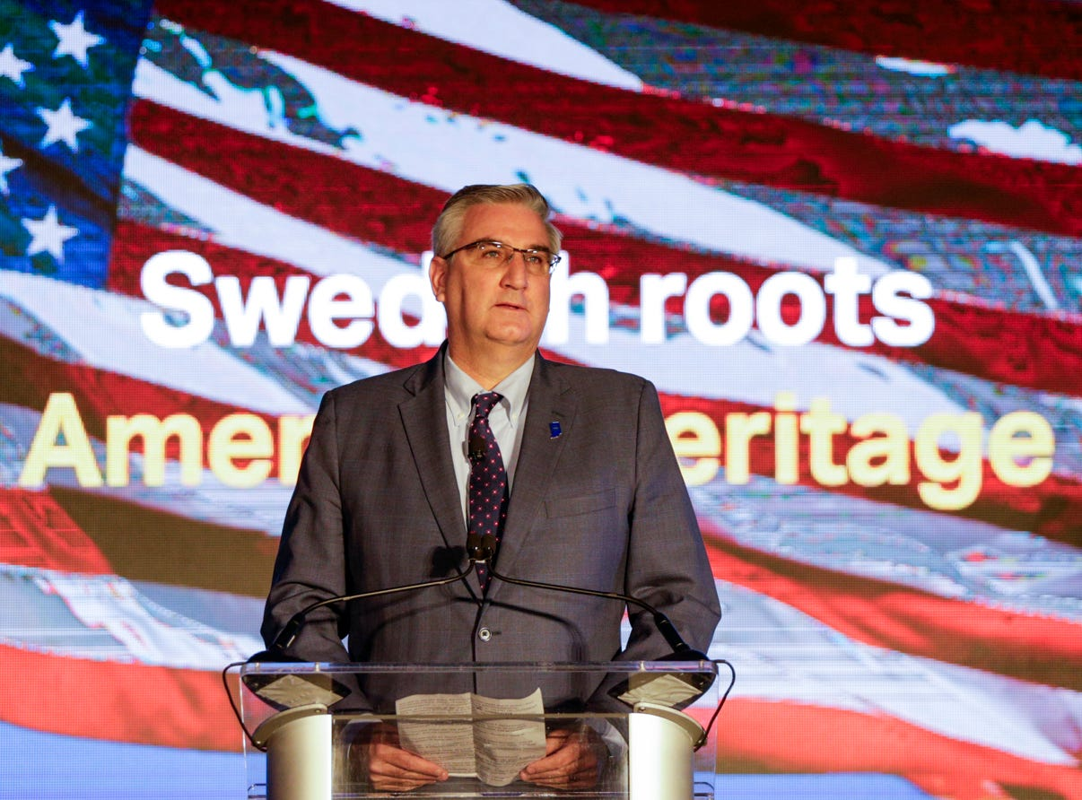 Gov. Eric Holcomb speaks during an announcement for a new Saab jet plant in West Lafayette, part of a $1 billion west campus plan, Wednesday, May 8, 2019 at the Purdue University airport in West Lafayette.