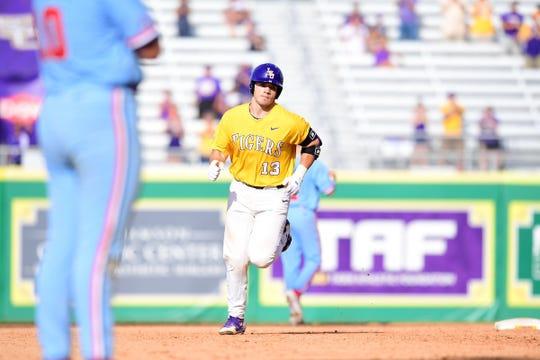 LSU baseball player Saul Garza rounds the bases.