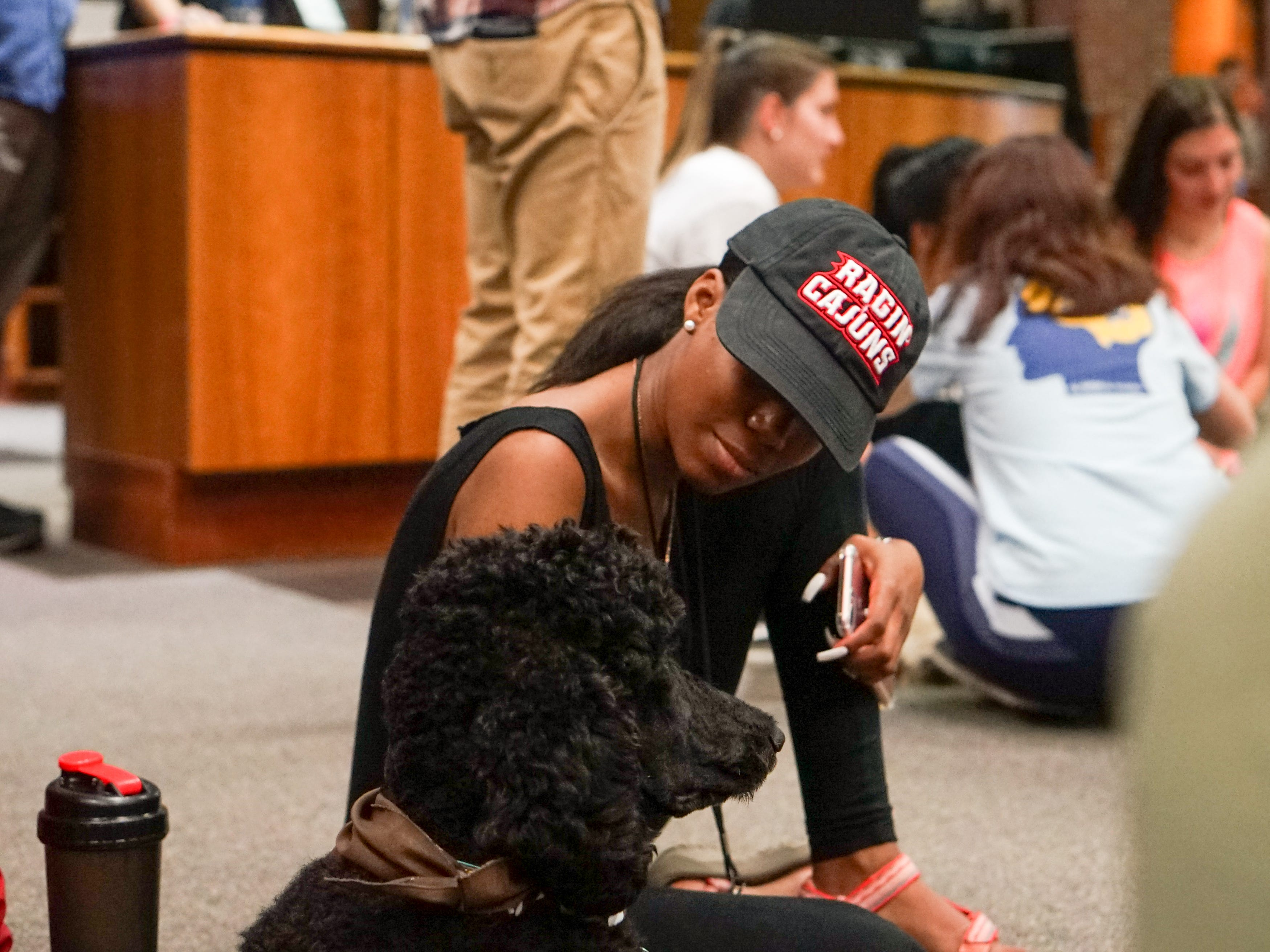 Students meet therapy dogs in the Edith Garland Dupré Library Wednesday, May 8, 2019. The University of Louisiana at Lafayette helps students to relieve stress during finals week by bringing therapy animals, to the library as part of Stress Relief Week. The therapy dogs are provided by Pet Partners of Acadiana, a non-profit organization with registered therapy animals, including birds, miniature horses, rabbits and  llamas.