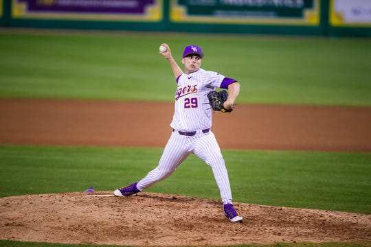 LSU pitcher Chase Costello delivers a pitch during a baseball game.