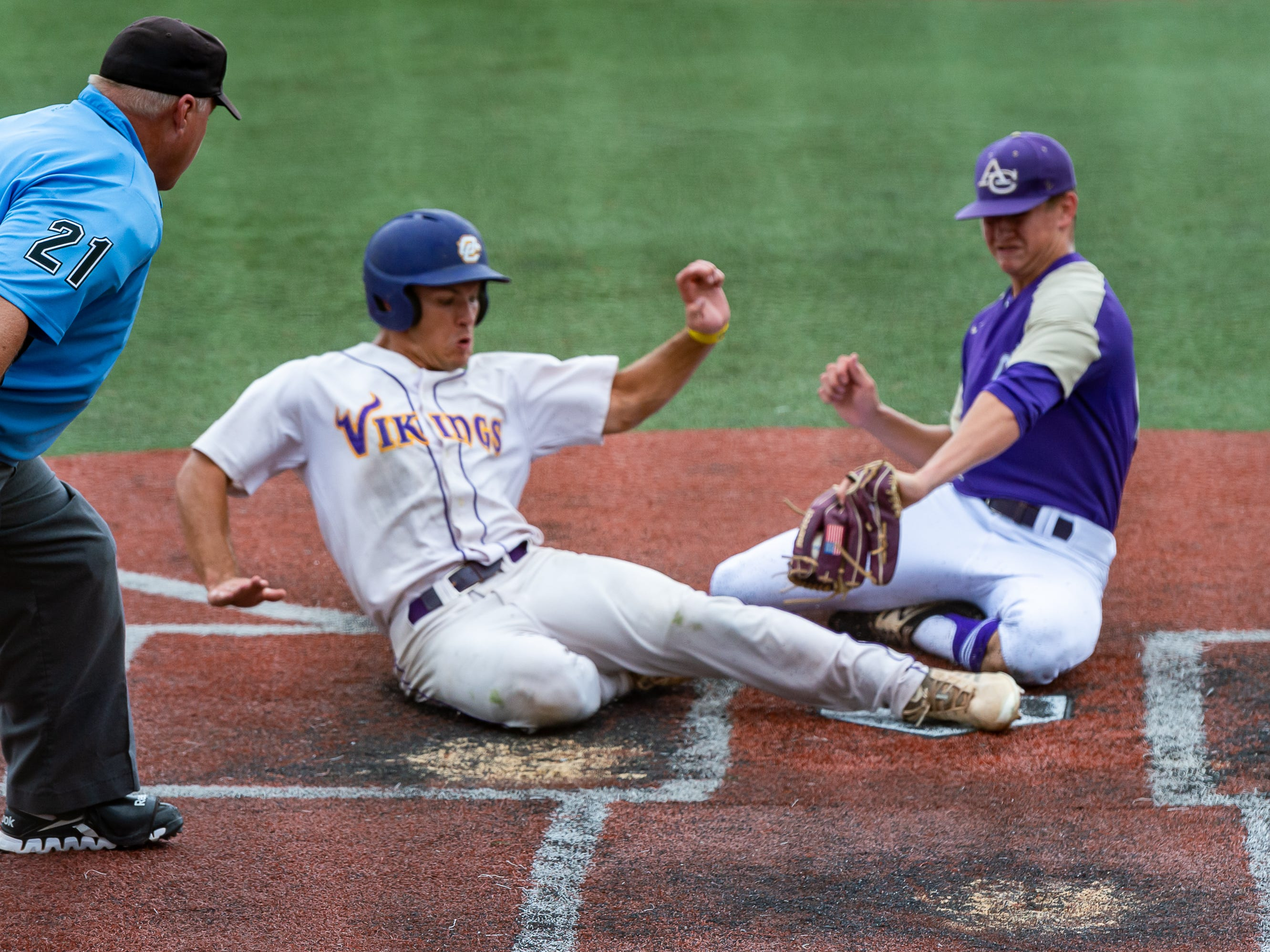 Sam Pitre slides into home to score a run as Opelousas Catholic takes on Ascension Catholic in the Div IV Semi Final game of the LHSAA State Baseball Championship. Wednesday, May 8, 2019.