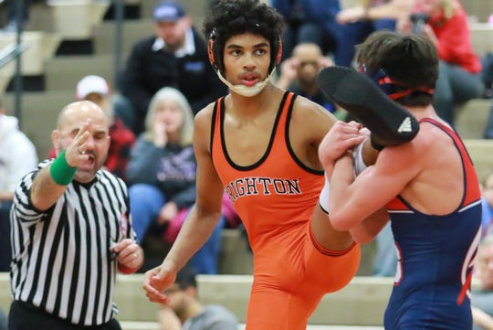 Brighton's Rhett Newton, third in the state at 140 pounds, will wrestle at Indiana Tech.