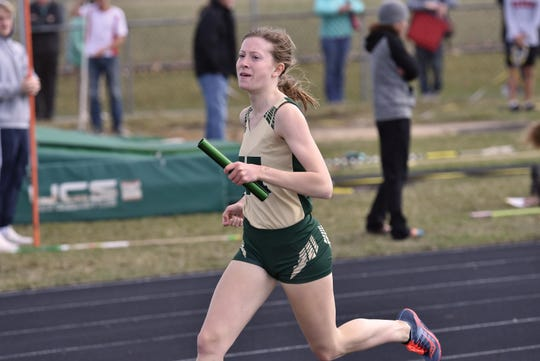 Howell's Ashlyn Tait won the 1,600, the 800 and was on a winning relay in a dual meet victory over Canton.
