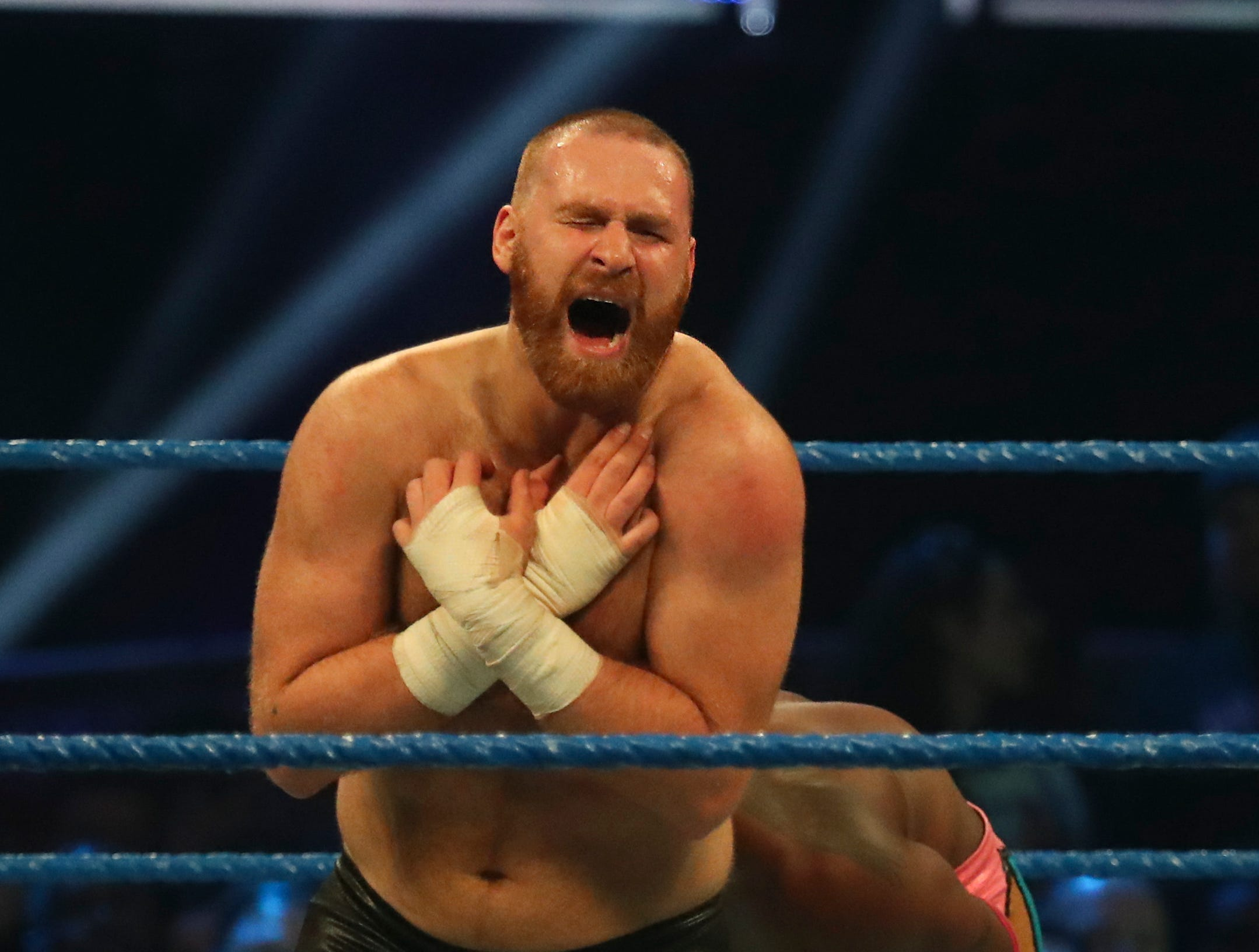 Sami Zayn is in pain after Kofi Kingston hit him during WWE Smackdown on May 7.