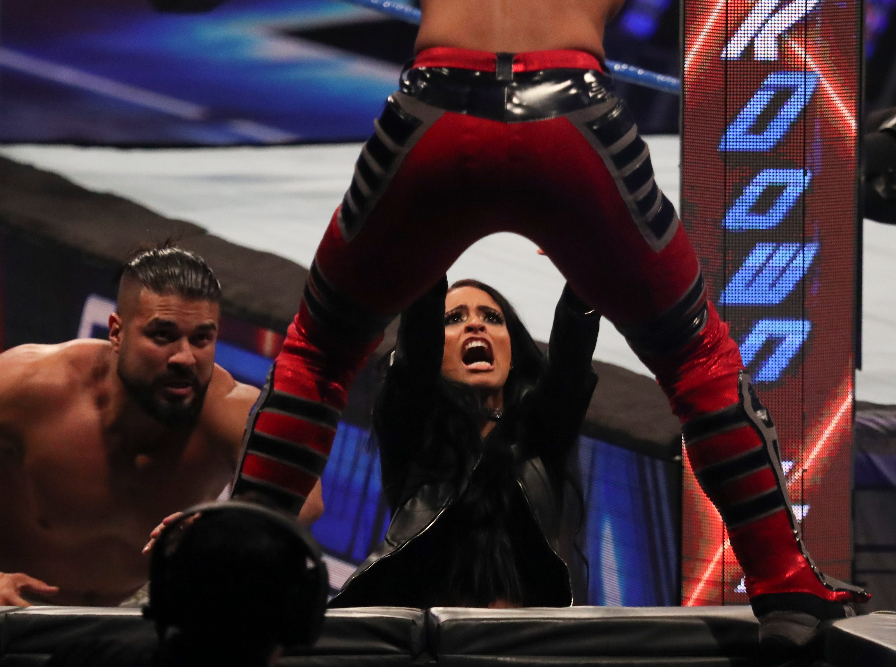 Zelina Vega and Andrade react to Ali during WWE Smackdown on May 7.