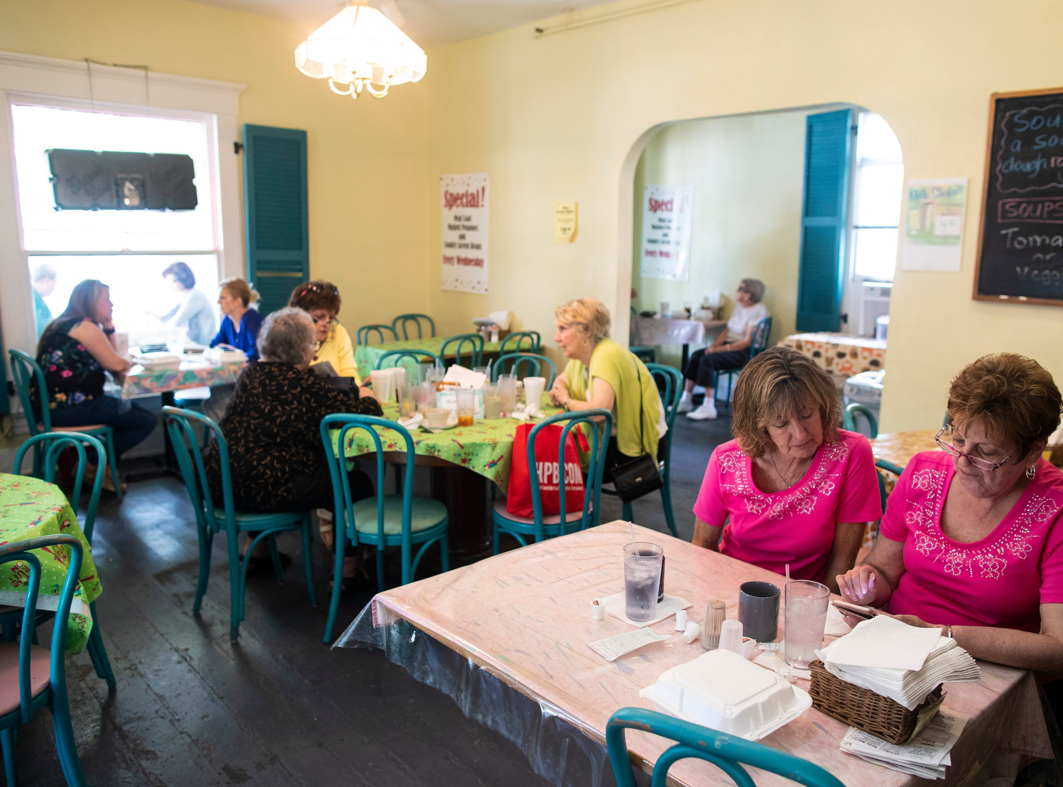 Patrons dine during lunch hour inside the Cottage Cafe in the Middletown neighborhood. May 8, 2019