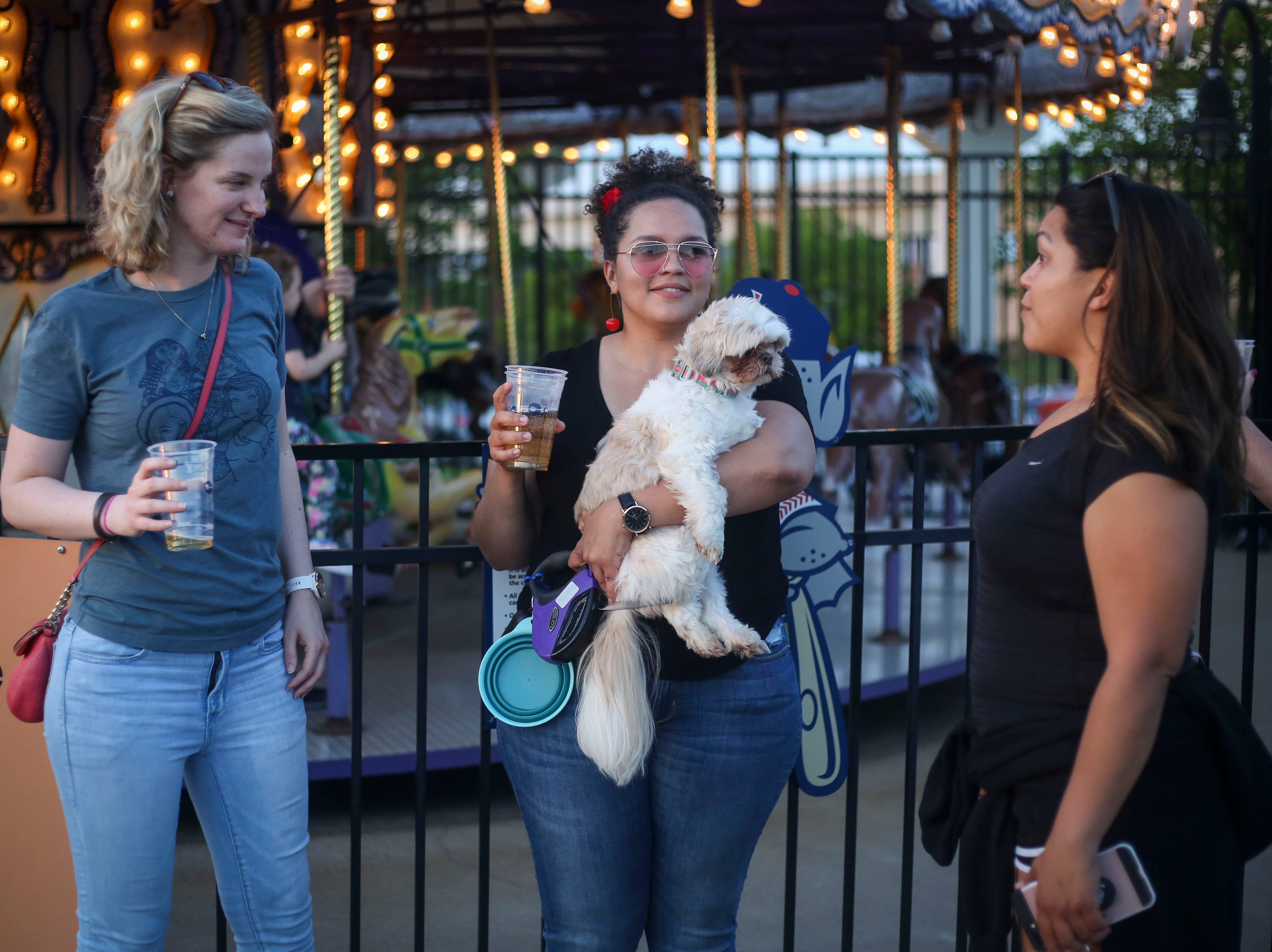 Bridget Smith holds Suge during the Louisville Bats v. Syracuse Mets game during Dog Day Nights at Louisville Slugger Field in downtown Louisville, Ky. on Tuesday, May 7, 2019.