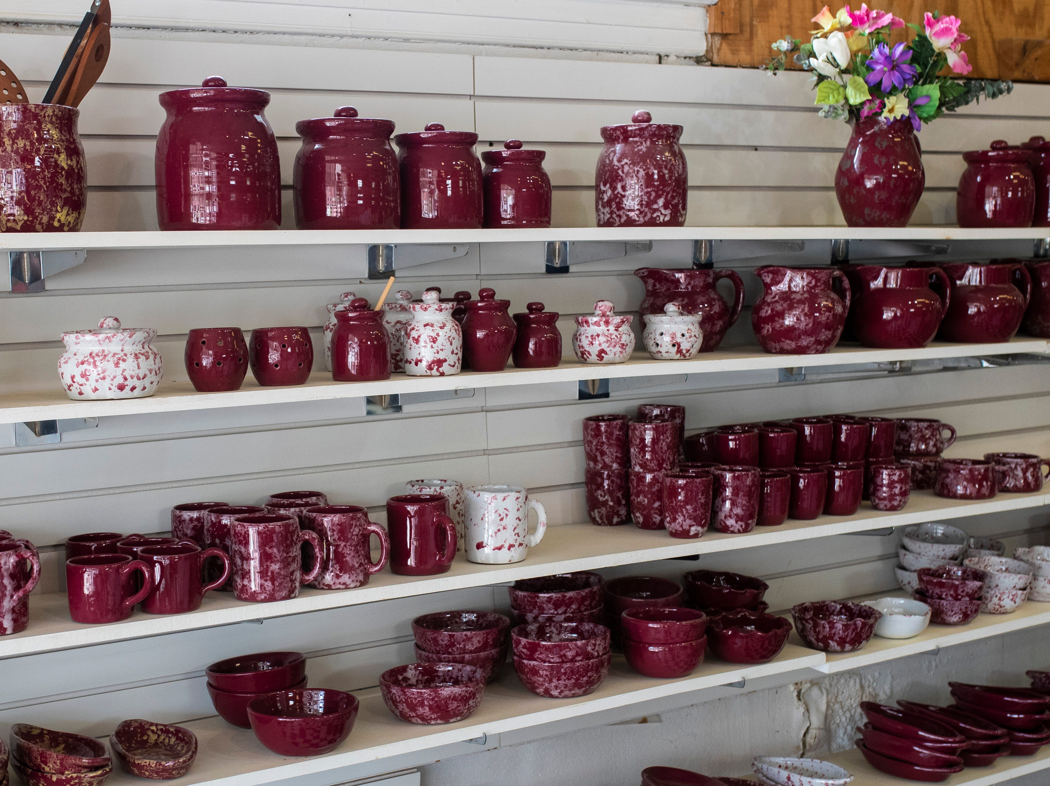 Potter for sale lines the shelves inside the Little Bit of Bybee pottery shop in the Middletown neighborhood. May 8, 2019