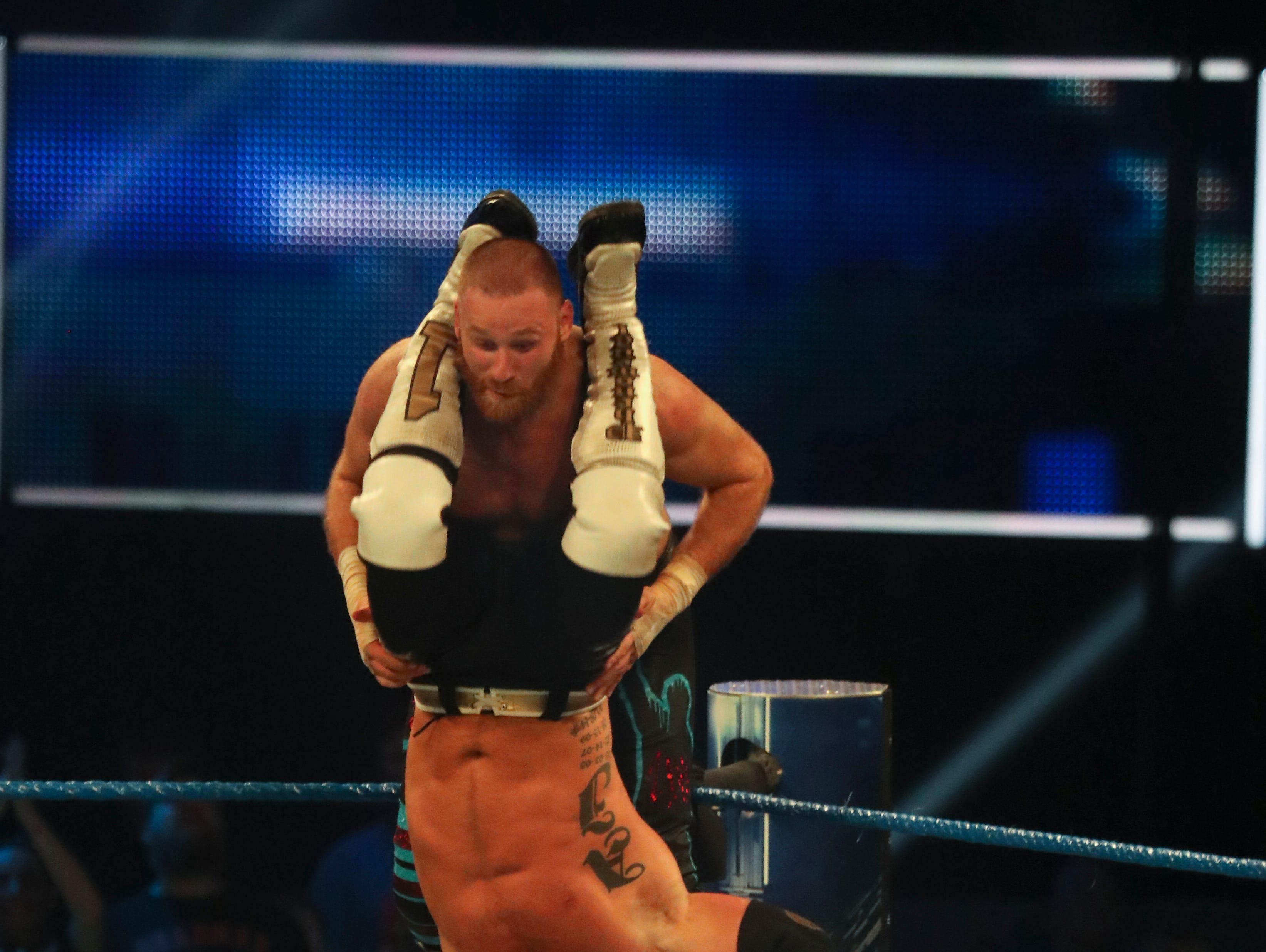 A.J. Styles puts a move on Sami Zayn during WWE Smackdown on May 7.