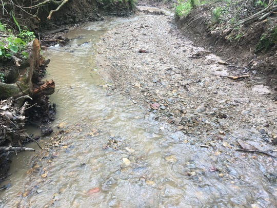 A section of Blue Lick Creek in Bullitt County on April 26, 2019 after it was contaminated by more than 200,000 gallons of concrete slurry earlier that month.