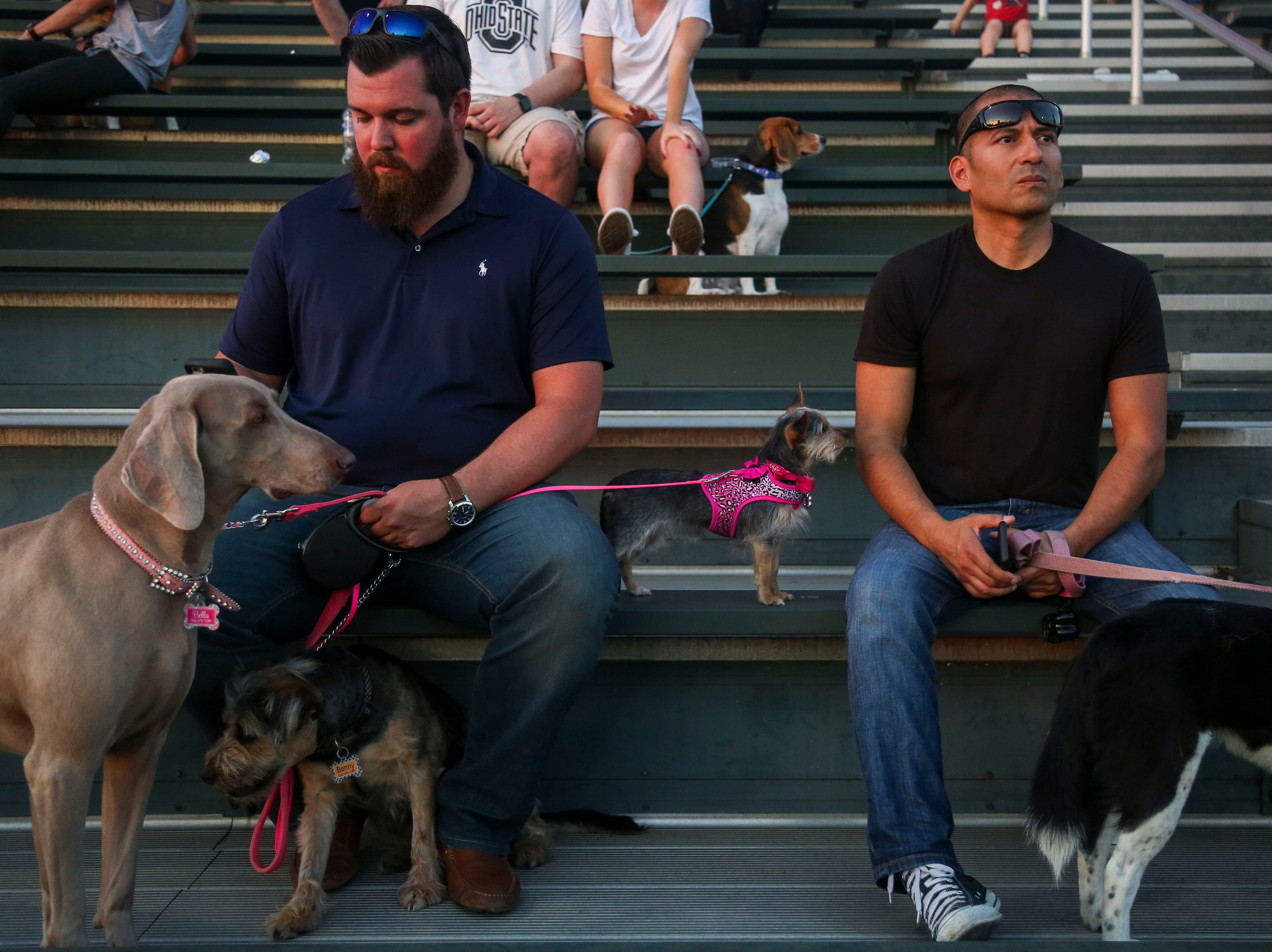Chris Cadle, left, and Gabe Tagle, right, watch the Louisville Bats v. Syracuse Mets game during Dog Day Nights at Louisville Slugger Field in downtown Louisville, Ky. on Tuesday, May 7, 2019.