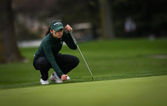 Michigan State junior golfer Allyson Geer-Park sizes up the green Wednesday, May 8, 2019, during the NCAA Div. 1 women's golf regional at Forest Akers West in East Lansing.