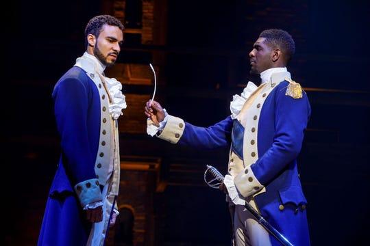"Austin Scott (left) and Carvens Lissaint as Alexander Hamilton and George Washington in ""Hamilton."""