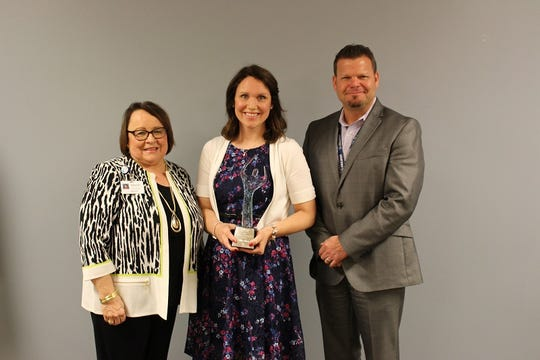 McLaren Greater Lansing hospital leaders and staff honored Abbie Sheets, RN, with the 2019 Nursing Excellence Award.