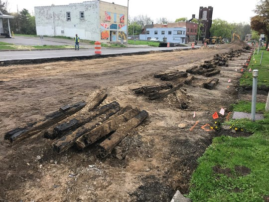 Wooden planks from what may have been a century-old road were spotted this week in Lansing's Old Town neighborhood on North Washington Avenue, south of Cesar E. Chavez Avenue.