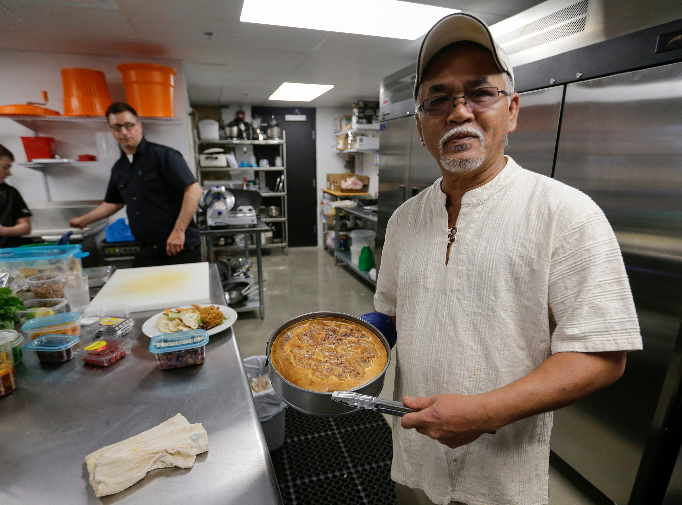 Chef Newey Boonperm shows off a new cheescake offering in the kitchen of the Waterfront Wine Bar Saturday, May 4, 2019, in Manitowoc, Wis. Joshua Clark/USA TODAY NETWORK-Wisconsin