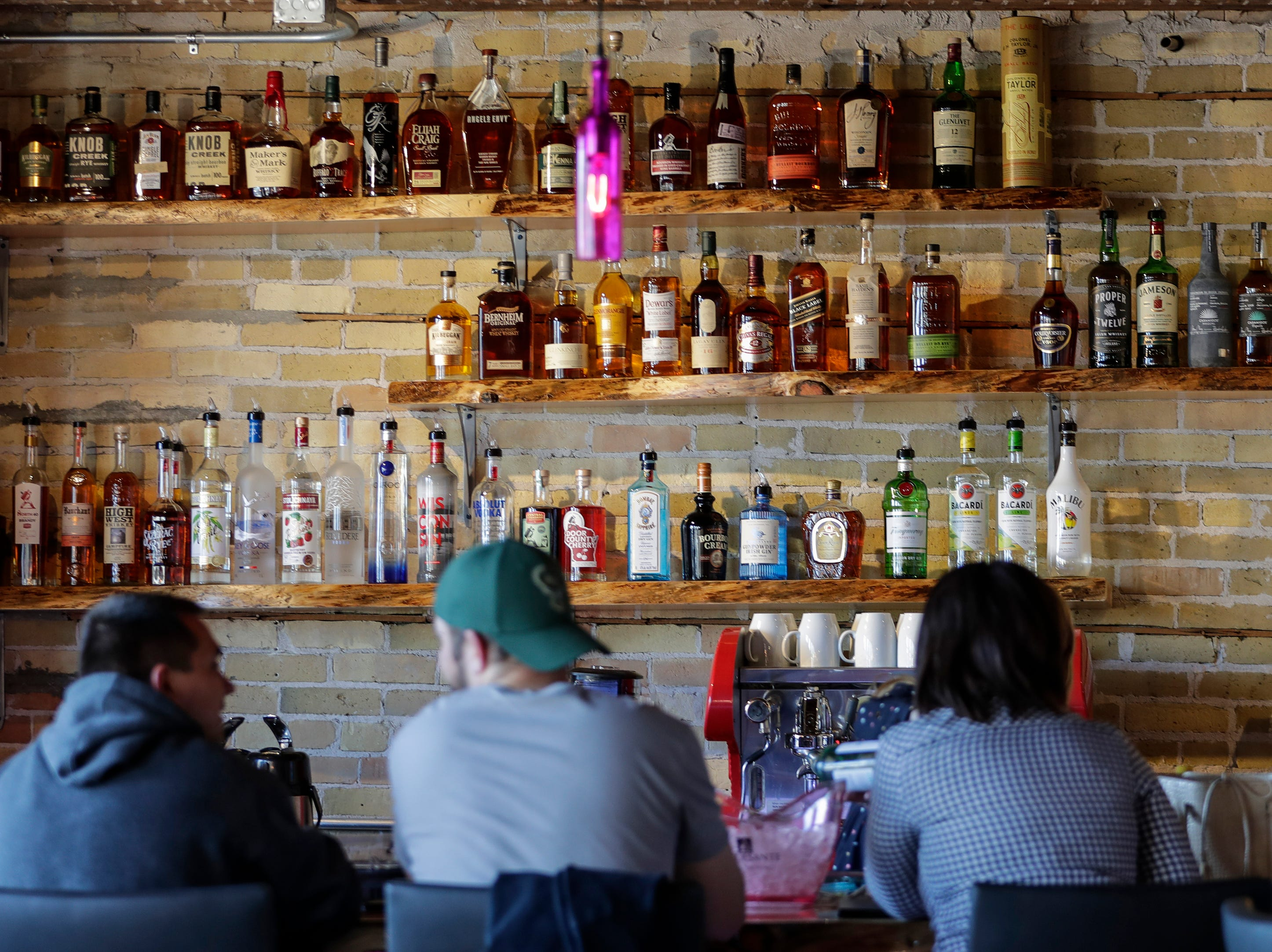 Liquor offerings on display behind the bar at the Waterfront Wine Bar Saturday, May 4, 2019, in Manitowoc, Wis. Joshua Clark/USA TODAY NETWORK-Wisconsin