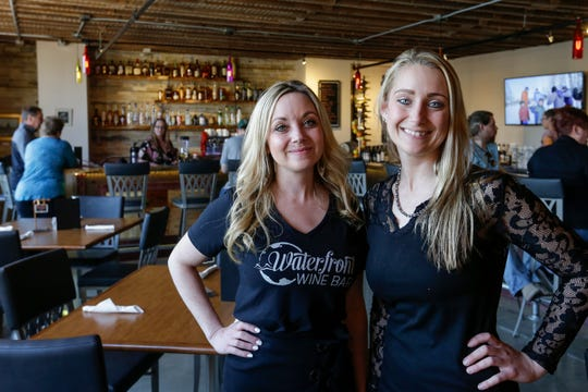 Sisters Rachel Beck and Megan Lausen at the Waterfront Wine Bar Saturday, May 4, 2019, in Manitowoc, Wis. The sisters opened the first riverfront establishment in Manitowoc. Joshua Clark/USA TODAY NETWORK-Wisconsin