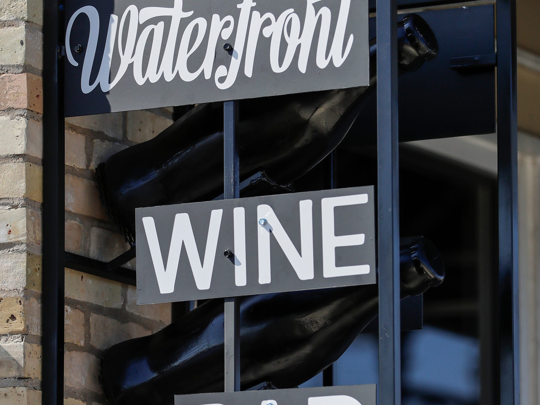 A small sign at street level for the Waterfront Wine Bar Saturday, May 4, 2019, in Manitowoc, Wis. Joshua Clark/USA TODAY NETWORK-Wisconsin