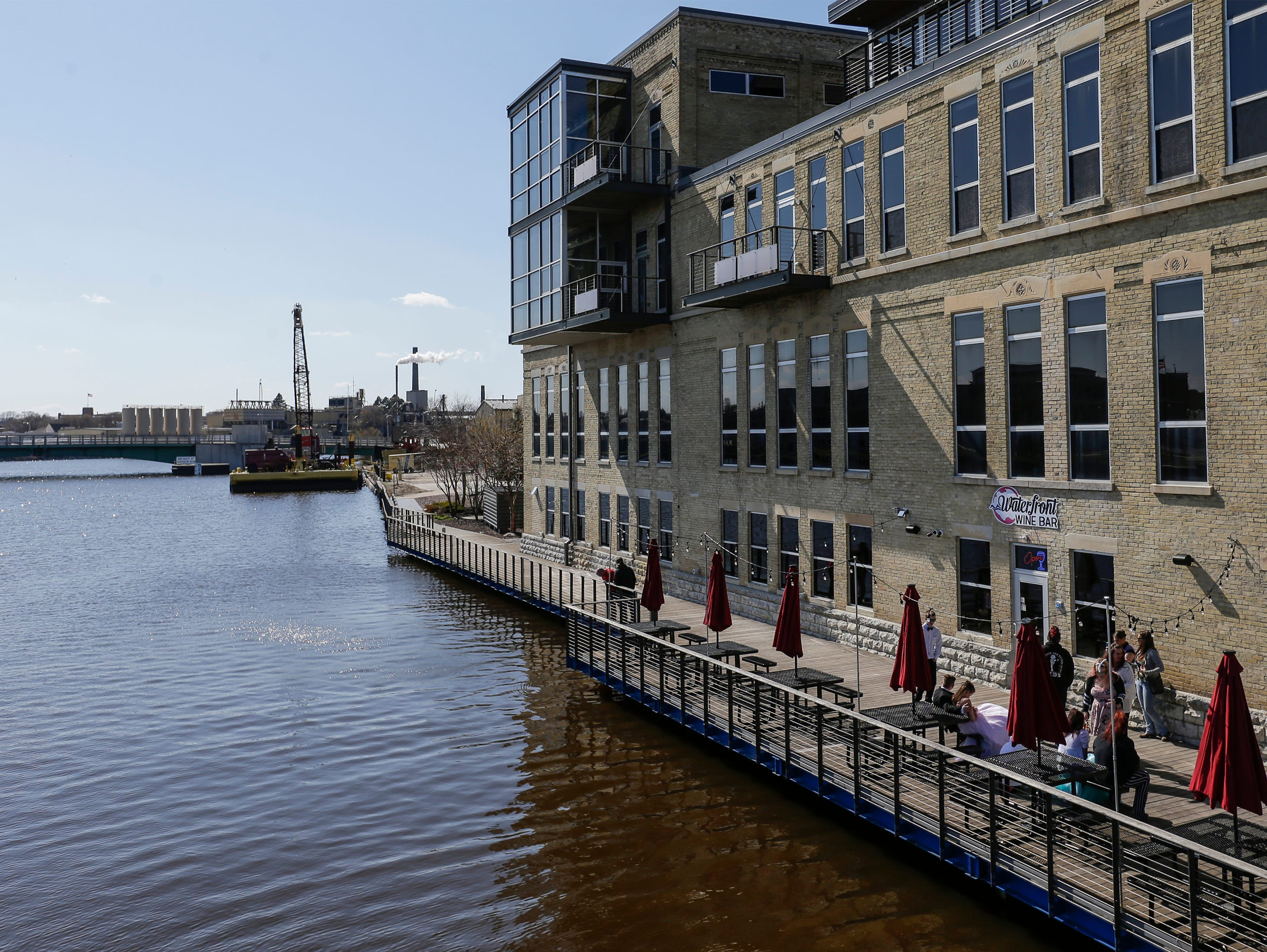 Outdoor seating alongside the Manitowoc River at the Waterfront Wine Bar Saturday, May 4, 2019, in Manitowoc, Wis. Joshua Clark/USA TODAY NETWORK-Wisconsin
