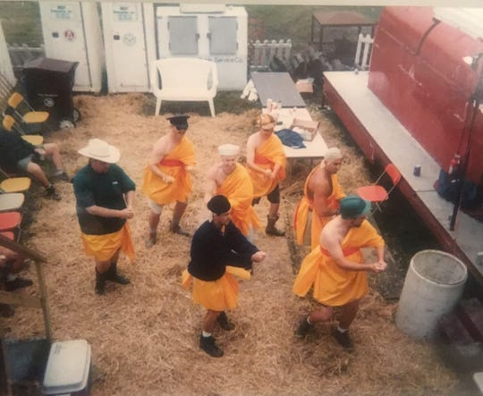 In the early years, Barbecue Republic participated in every event. In honor of Thailand in 1995, they dressed up as monks and prepared a dance.  Here they are practicing in their booth before heading to the competition.