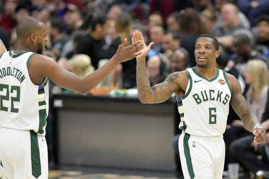 Bucks forward Khris Middleton and guard Eric Bledsoe celebrate during a game in March against the Cavaliers.