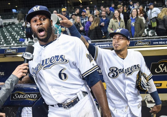 Lorenzo Cain gets a minidunk courtesy of Orlando Arcia while doing a postgame interview after the Brewers' 6-0 victory over the Nationals on Tuesday night at Miller Park.