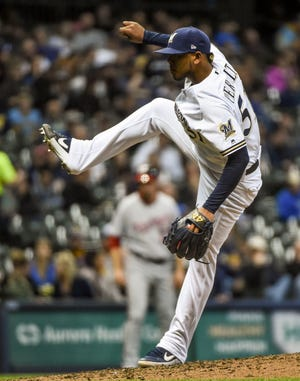Brewers pitcher Freddy Peralta throws a pitch in the fifth inning against the Nationals at Miller Park.
