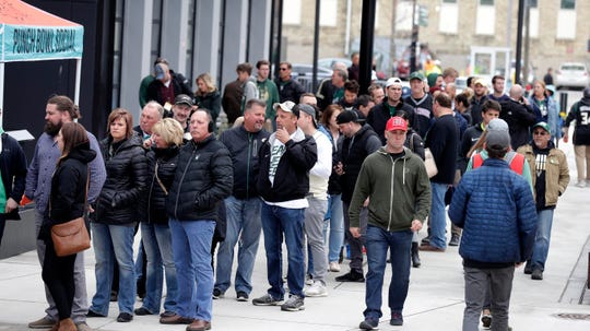 Fans stand in line at the Mecca Sports Bar and Grill before the Bucks vs. Celtics game Wednesday.