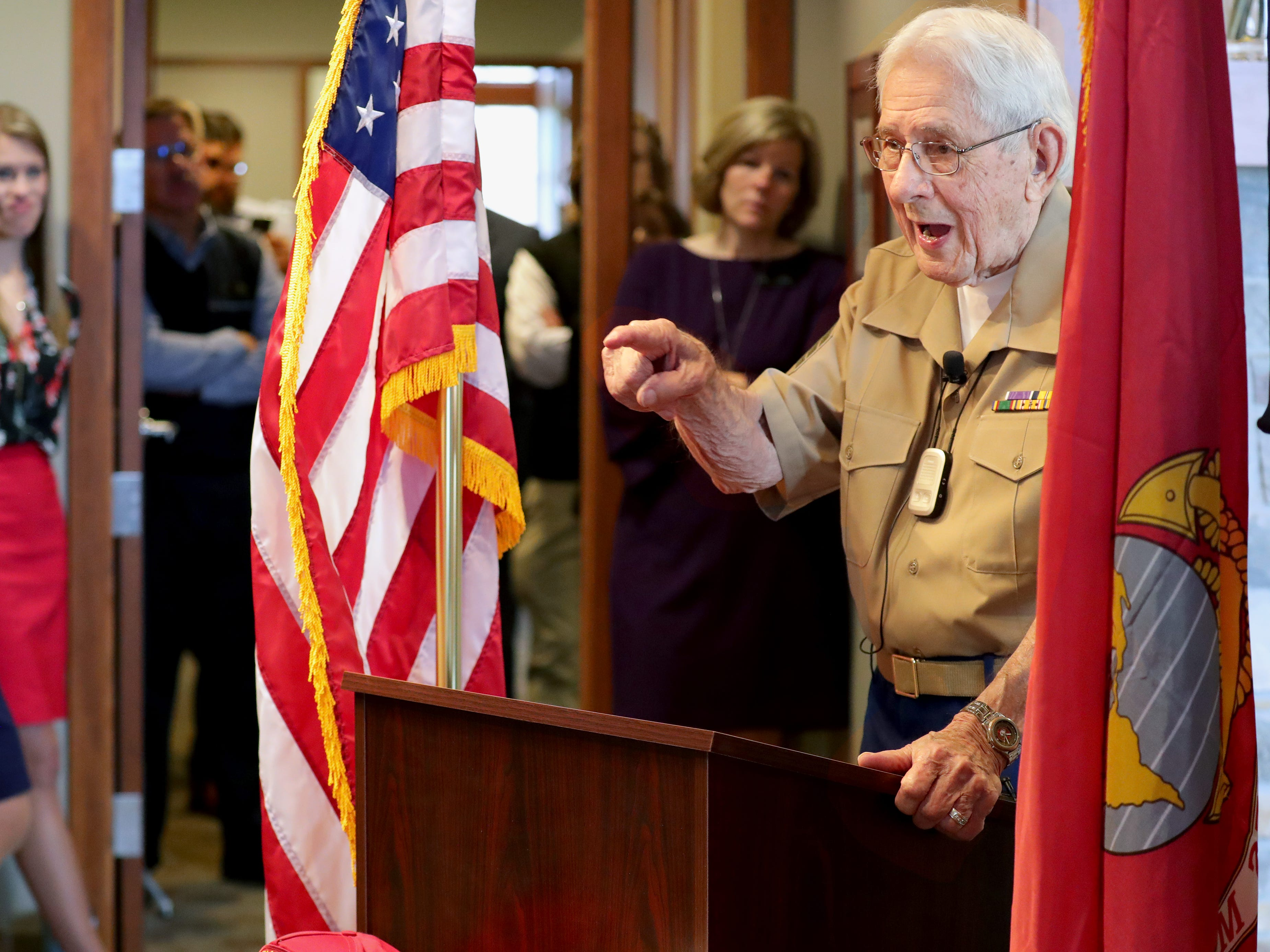 Sgt. Edgar Harrell speaks as an overflow crowd listens at Spectrum Investment Advisors in Mequon on Wednesday.  Harrell is the last surviving Marine from the World War II sinking of the USS Indianapolis, the ship that carried the atomic bomb to Tinian Island and was sunk by a Japanese submarine a few days after delivering its cargo.