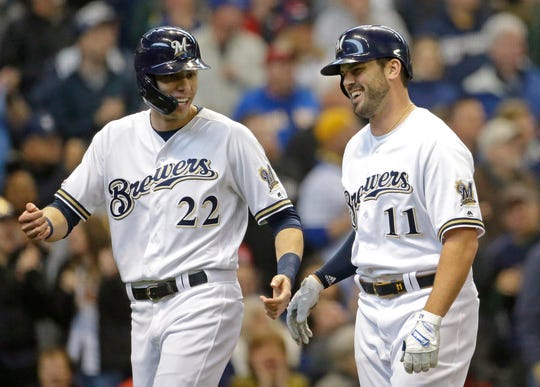 Milwaukee Brewers' Mike Moustakas (11) celebrates with Christian Yelich (22) after hitting a two-run home run during the second inning of a baseball game against the Washington Nationals Wednesday, May 8, 2019, in Milwaukee. (AP Photo/Aaron Gash) ORG XMIT: WIAG110
